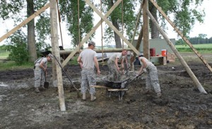 Soldiers from the 424th Engineer Company of Rutland, Vermont, didn't let rain and mud stop them from accomplishing their mission while on the SDSU campus in June. The Vermont Army Reservists were on campus to start construction of the Goodale-Renz ROTC Confidence Obstacle Course, which is being funded by SDSU alumni Gene and JoAnn Goodale of Pekin, Illinois.