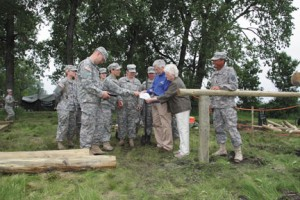 Gene and JoAnn Goodale of Pekin, Illinois, visit with military personnel at  the construction site of the Goodale-Renz ROTC Confidence Obstacle Course on June 14. The obstacle course was constructed by the 153rd Engineer Battalion of Huron, South Dakota, and the 424th Engineer Company of the Vermont Army Reserve. The Goodales, both SDSU graduates, are funding the ROTC course in honor of their family's U.S. military service.