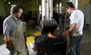 The forge in the blacksmithing shop of Solberg Hall runs hot for engineering students Logan Janssen, right, and Chad Guzinski as they work on their blacksmithing creation.