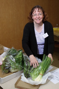 South Dakota Local Foods Cooperative member Elizabeth Fox sorts greens that will be distributed the next day to those who have ordered them.