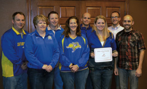 The Pride of the Dakotas Alumni Chapter is governed by a nine-member board of directors. They are, from left, Steve Johnson, Paula Derickson, Dave Jones, Steph Broderson, Mike Uken, Jen Cady (president), Jesse Miller and Dan Carlson. Not pictured is Kevin Kessler.