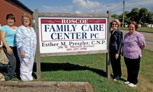 The staff of Family Care Center in Roscoe, from left, business manager Gail Scherbenski, registered nurse Dee Bauman, family nurse practitioner Esther Preszler '88/MS '95, and registered nurse Kari Malfam.