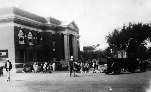 When President Calvin Coolidge visited the campus Sept. 10, 1927, the famous tree was there, branches spread above the truck at right in this scene looking west toward Lincoln Library, at left.