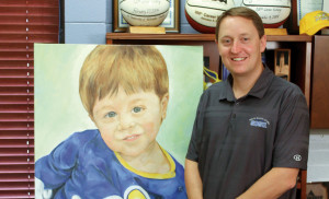 SDSU women's basketball coach Aaron Johnston with the painting of his son, Dylan, which Stuart created in 2013.