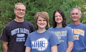 From left, Kevin Wurtz '75, Kim Wurtz '14, Allison Akin '03 and Dean Schmiedt '73 pose at a recent family gathering. They represent the most recent generations of State pharmacy graduates in the family, a line that dates to 1925.