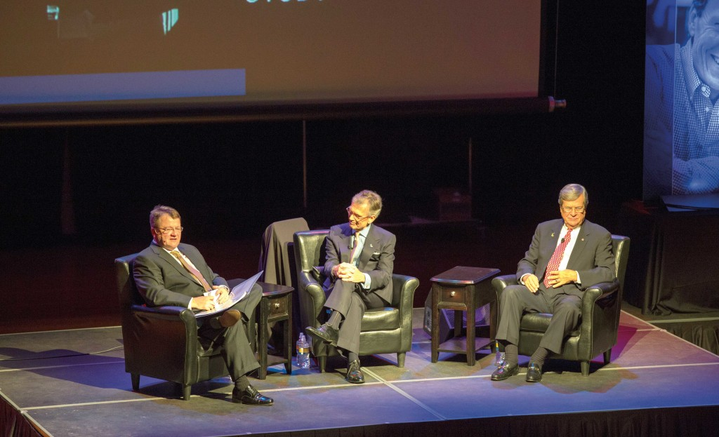 From left, Chuck Raasch '76, Tom Daschle '69 and Trent Lott sit on the stage at the Performing Arts Center. Raasch served as the moderator for the first Daschle Dialogues held Oct. 14.