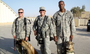 While in Jordan providing security for an exercise, Gacke poses with two dog handlers who were active duty members of the U.S. Air Force.