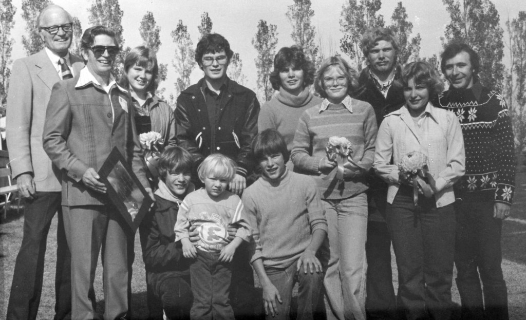 The Joe and Marge Gunn family was honored as SDSU's first Family of the Year at halftime of the Family Day game Oct. 13, 1979. Pictured, back row, from left, are SDSU President Sherwood Berg, patriarch Joseph Gunn (with plaque) and his children, Theresa, Steve, Mary (now Sieler), Jennifer (now Brynjulson), Paul, Diane (now Gildemaster), Students' Association President Jerry Schmitz. Kneeling, from left, Jeff, Patrick and Scott. Not pictured are the mother, Marjorie, who was in Huron conducting a South Dakota Federation of Garden Clubs state meeting, and sister, Deb, who was in Washington, D.C., working for the Department of Health, Education and Welfare.