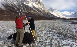 Grant Hilderbrand, left, and helicopter pilot Troy Cambier of Chena River Aviation weigh a brown bear along the upper Kijik River in Lake Clark National Park, Alaska, Oct. 6, 2014. Generally, Hilderbrand gathers specimen data after hibernation ends in the spring. This year he tranquilized 51 bears in 22 days in three parks.