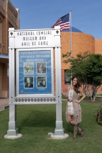 """Tara Trask poses outside the National Cowgirl Museum and Hall of Fame in Fort Worth, Texas. The former Miss Rodeo South Dakota, who is now public programming director at the museum, says """"Texas has my heart, but South Dakota has my soul."""""""