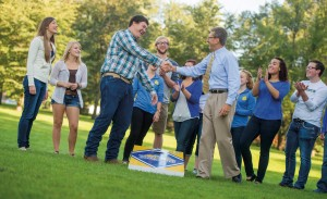 President David Chicoine competes against Students' Association President Caleb Finck in a beanbag toss event at the Coolidge Sylvan Theatre. Chicoine, who announced his plans to step away from being the university president in December, defeated Finck.