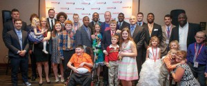 Children with brain tumors, former Huskers and keynote speaker and cancer survivor Jim Kelly (center, back) gather at the 2016 Team Jack Gala.