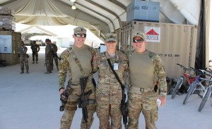 During one of her three deployments, Leah Anderson stands with her sons, Justin Hassebroe, left, and Marcus Short, right, at Kandahar, Afghanistan.